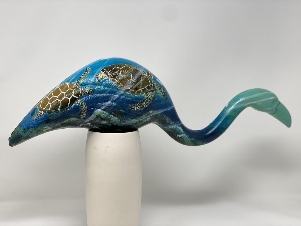 An image of a painted flamingo with turtles and ocean colors, being auctioned off at the inspire virtual auction